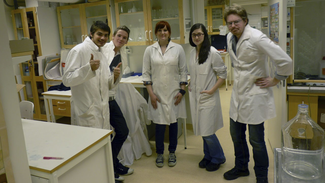 A group of students in lab coats at the Environmental Archaeology Laboratory