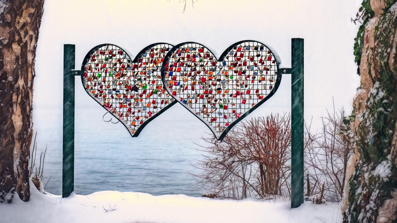 Art of hearts in front of open water in the wintertime